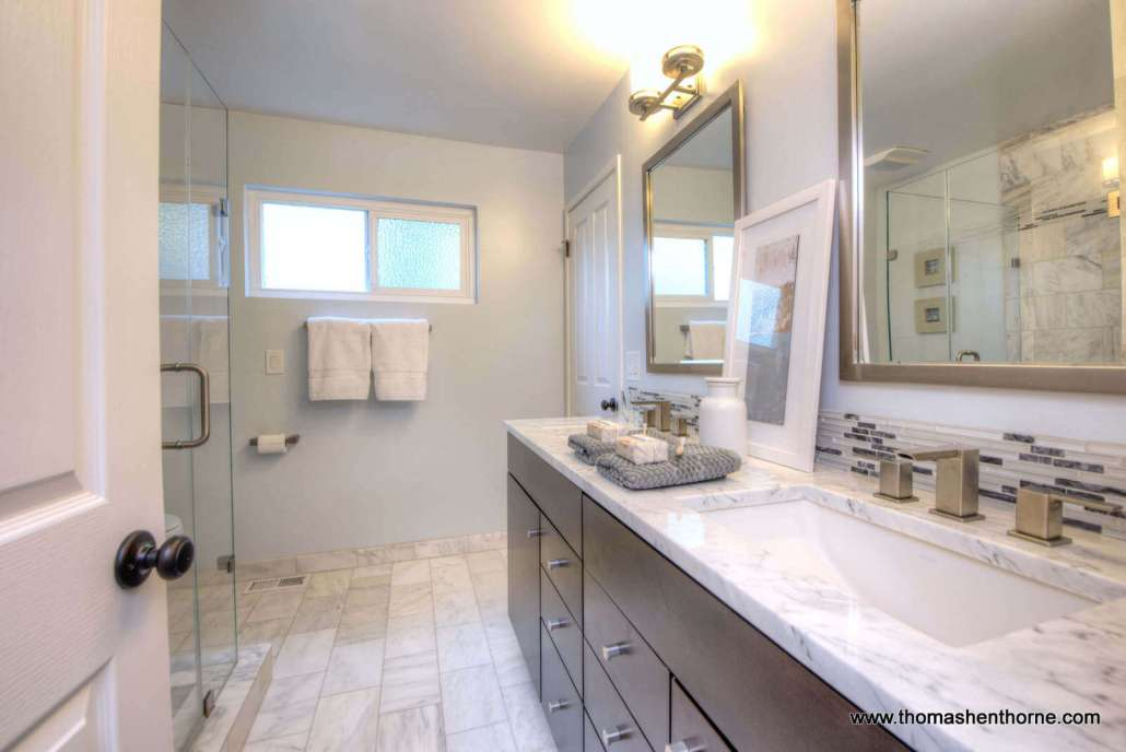 Master bathroom with marble shower and countertops 2