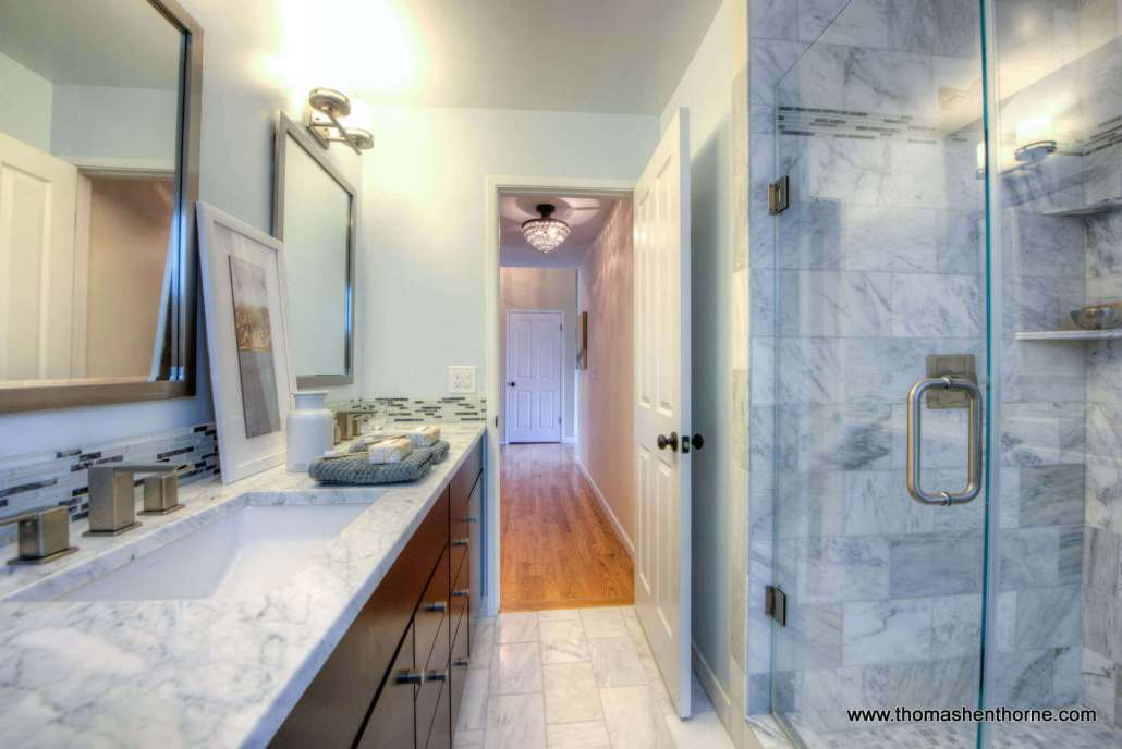 Master bathroom with marble shower and countertops