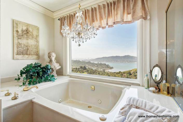 Soaking tub with chandelier and view of Golden Gate Bridge