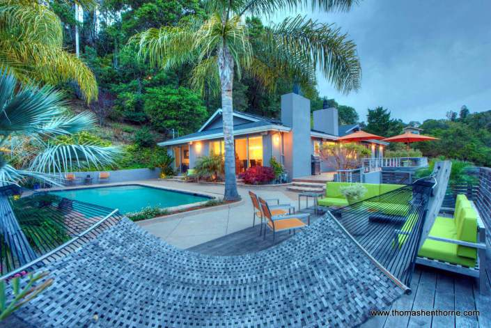 Hammock with pool and home in background