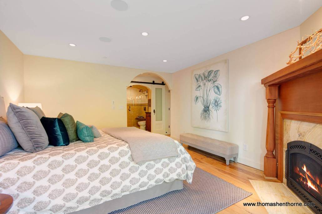 Bedroom with fireplace in corner