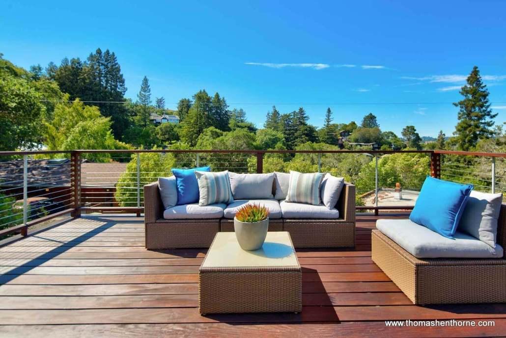 Outdoor wicker furniture on wood deck