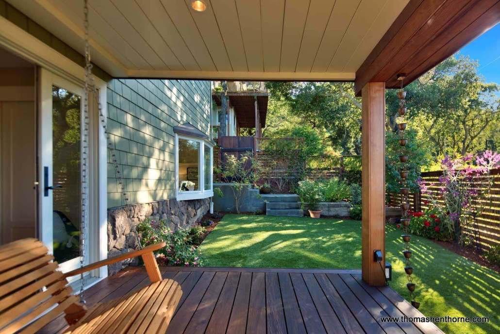 porch swing and lawn with bay window