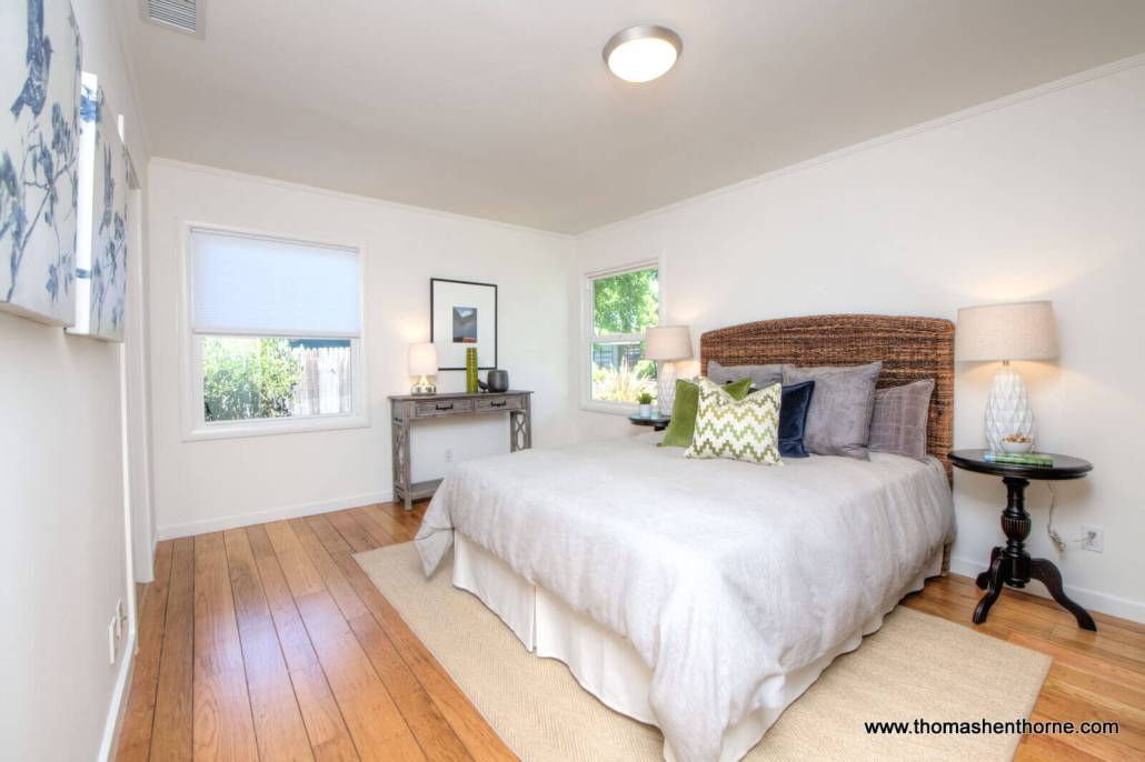 Bedroom with neutral colored comforter