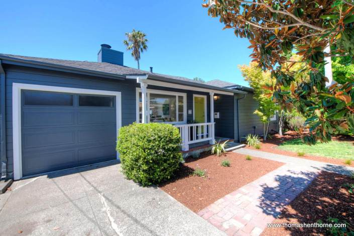27 Dolores Street San Rafael front view with grey siding and white trim, bright green door