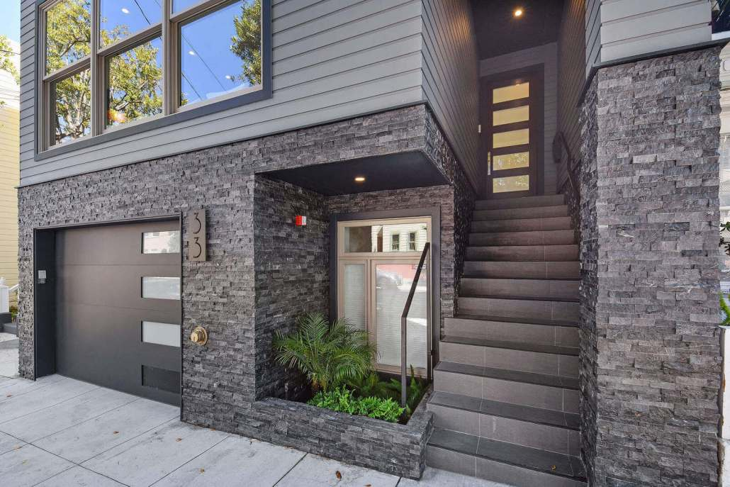 Modern entrance with front door and stairway