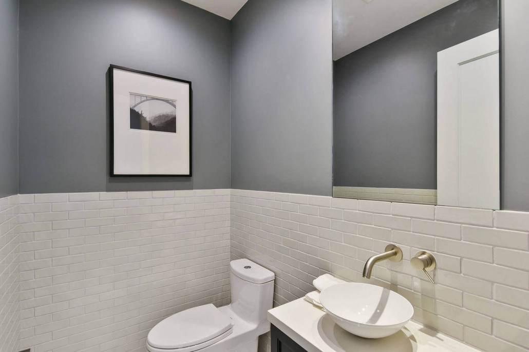 Modern bathroom with luxury fixtures and custom tile