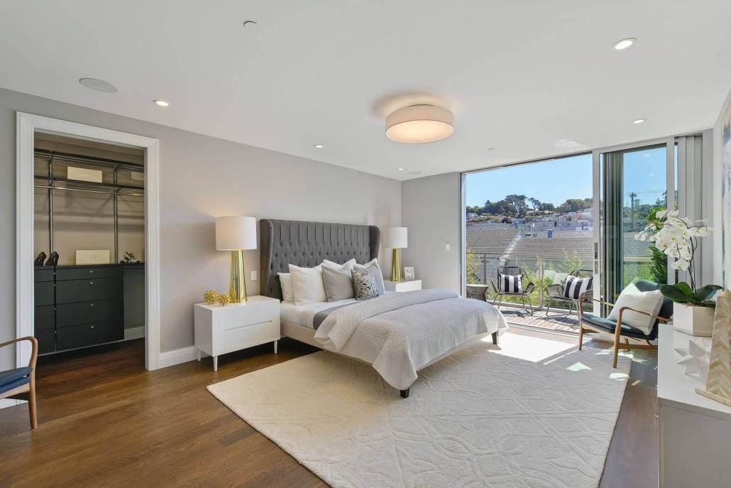 Bedroom with glass sliding doors open to deck