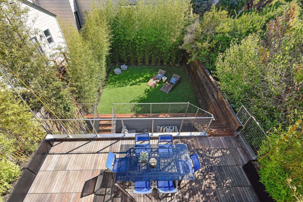 Aerial view of modern luxury deck with table and chairs