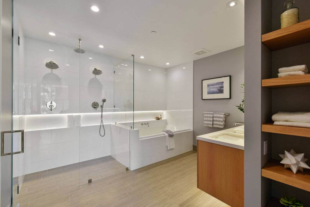 Modern luxury bathroom with dual showers and soaking tub