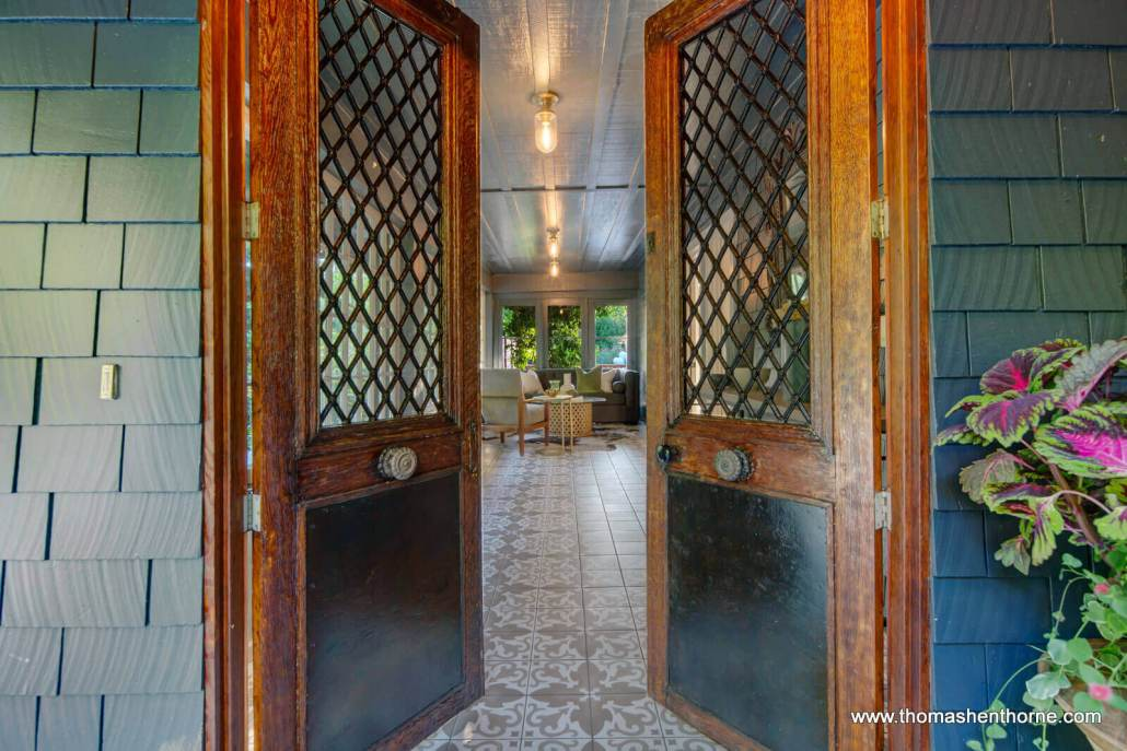 Antique Metal wood and glass front double entry doors