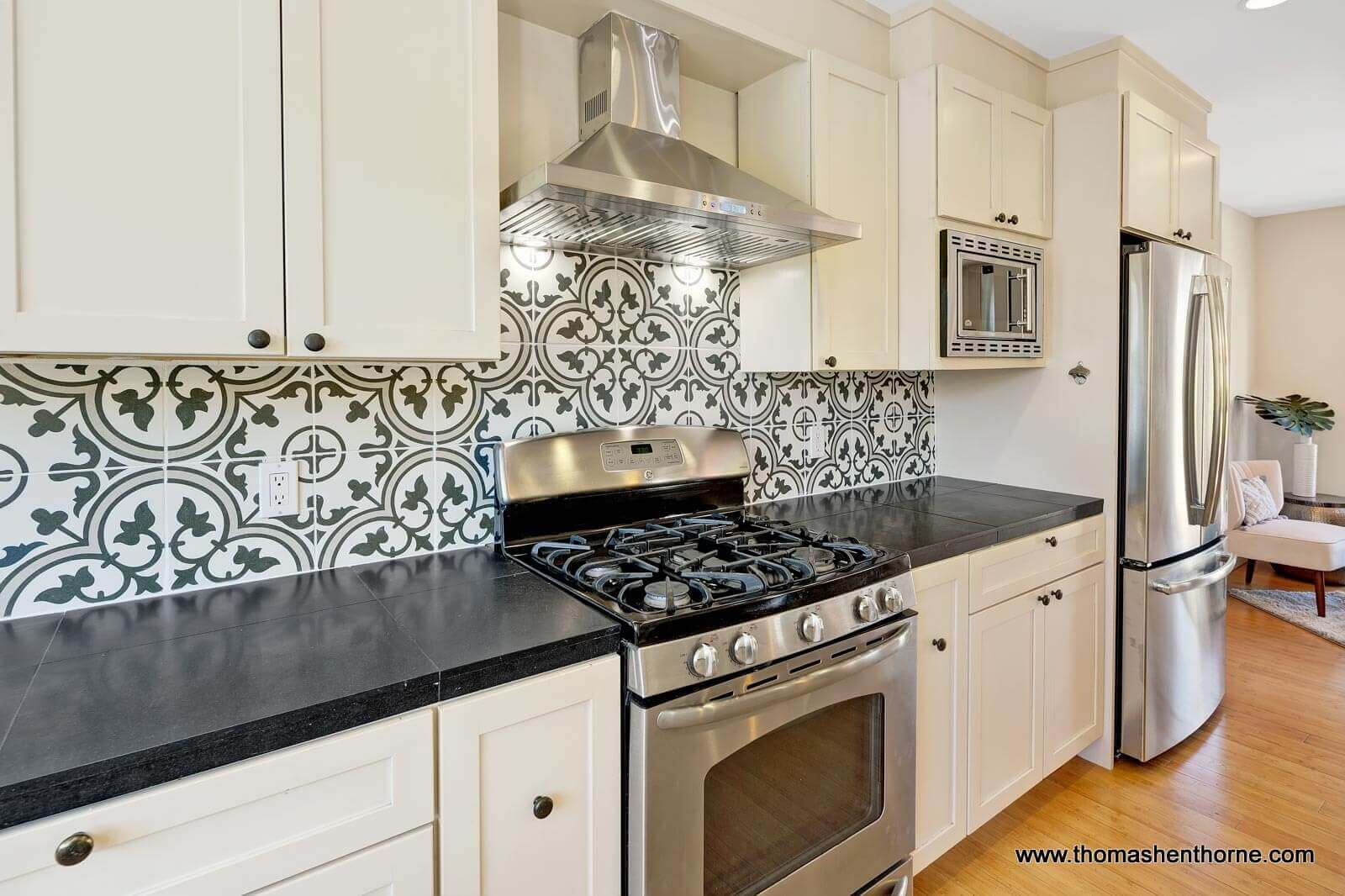 Kitchen with tile backsplash and stainless appliances