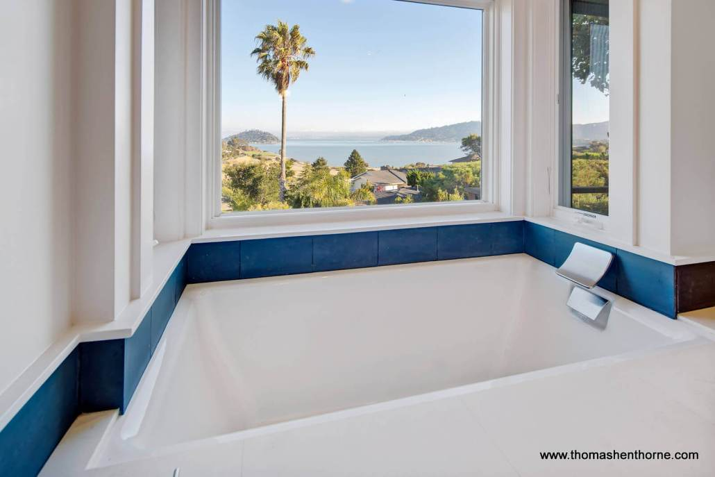 Soaking tub with large window and view of San Francisco bay