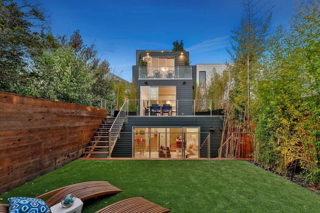Modern home with yard and decks