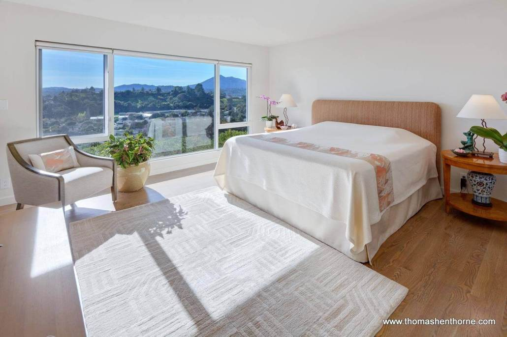 Bed with window and view of mountains