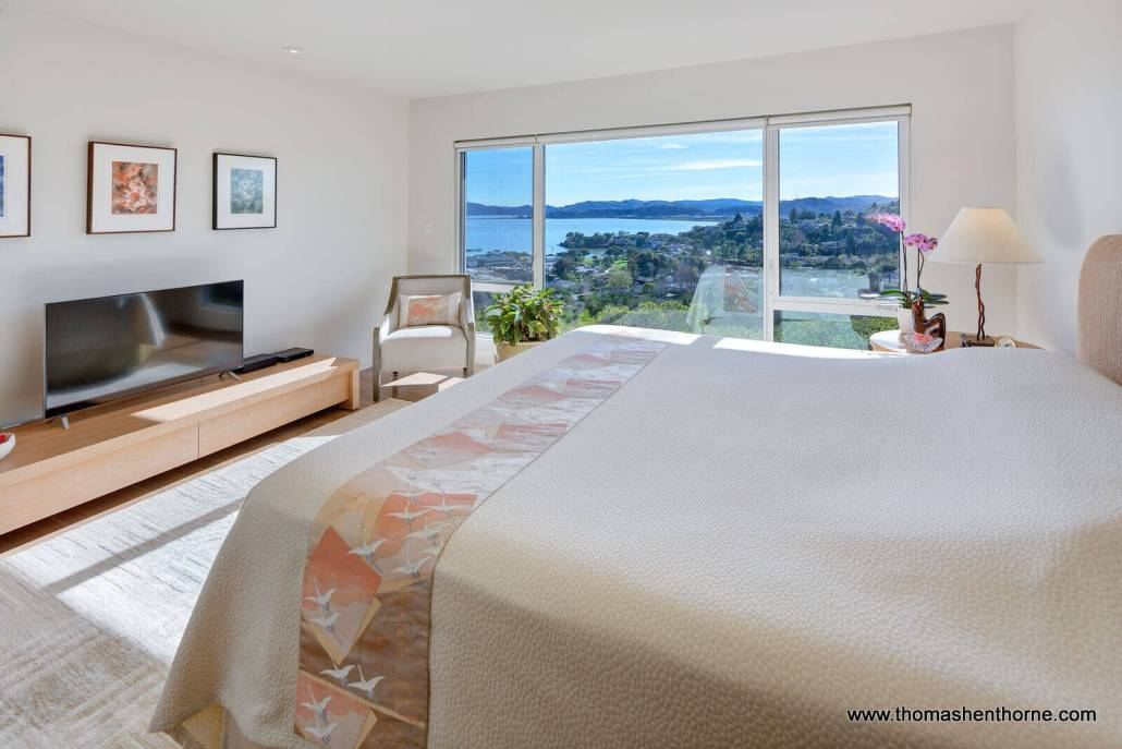 Bed with window in distance and view
