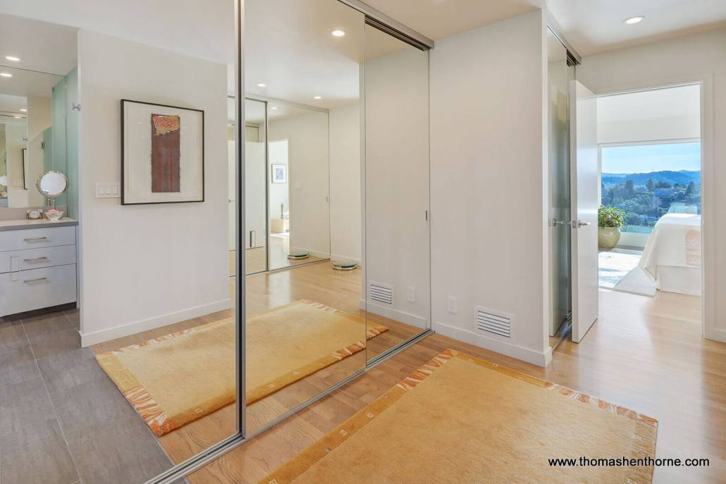 Closets with glass mirror doors