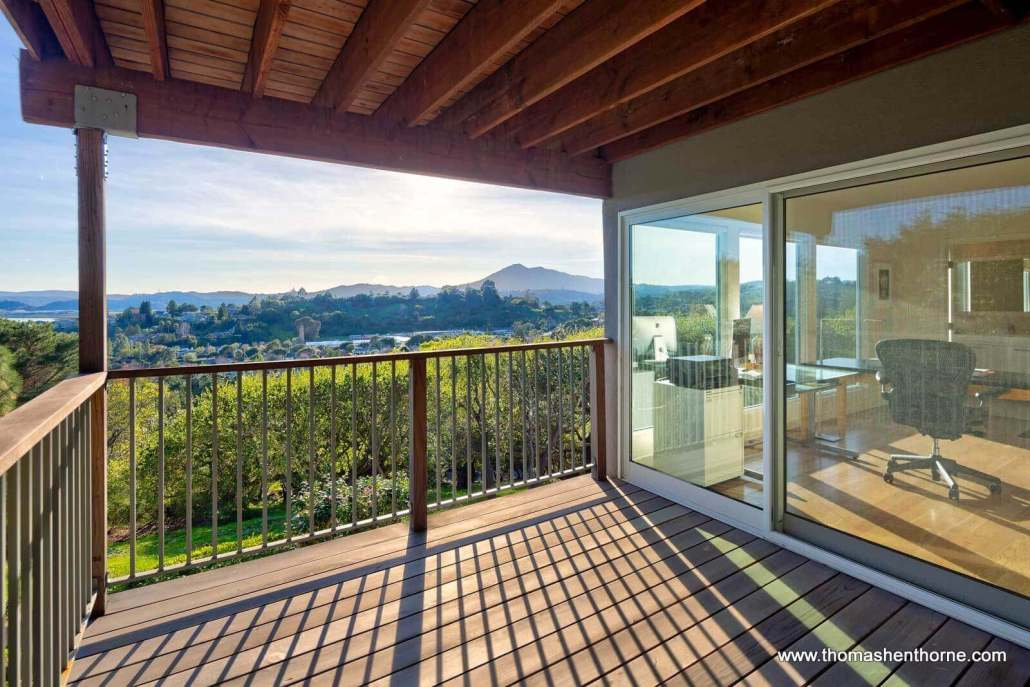 Wood deck off office with sliding glass doors