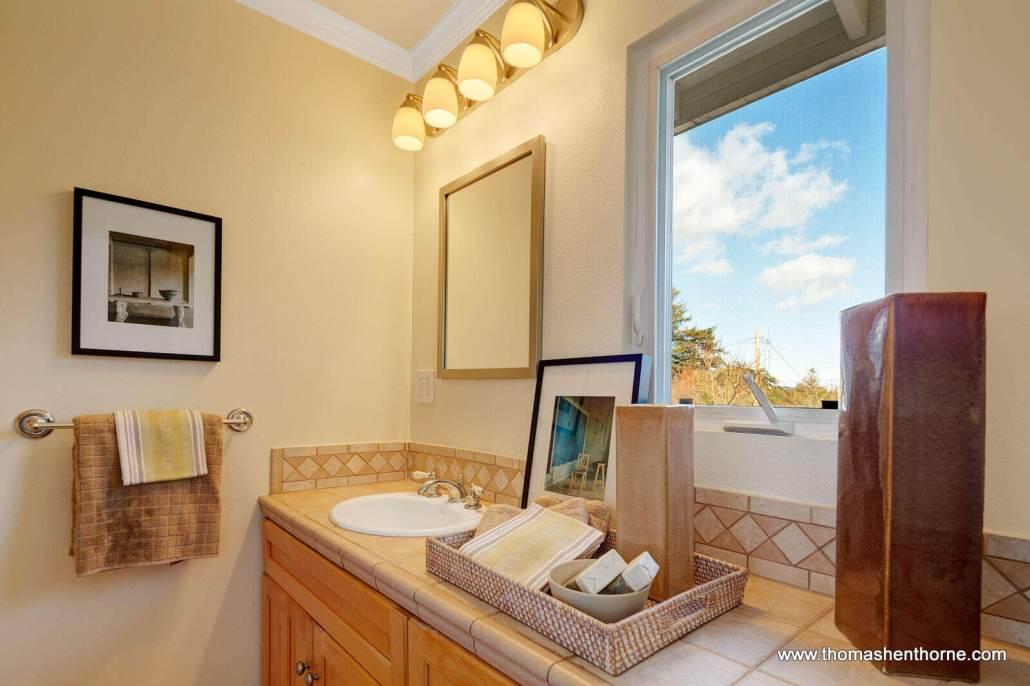 Master bathroom with window over vanity