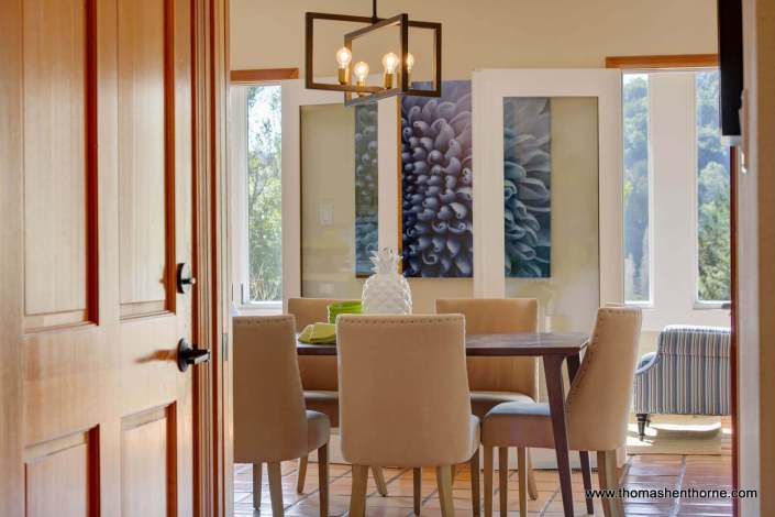 Dining table and chairs with modern light fixture