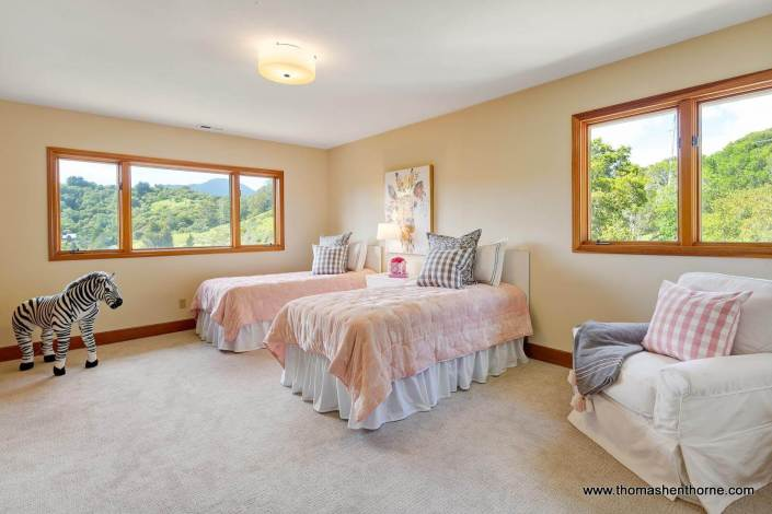 Bedroom with Two Twin beds with pink comforters
