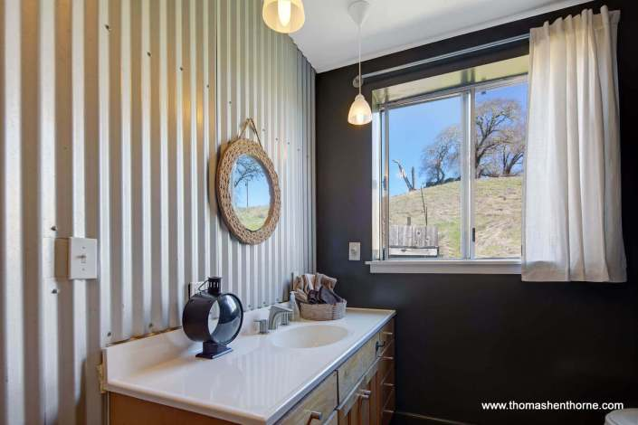 Bathroom with corrugated metal walls