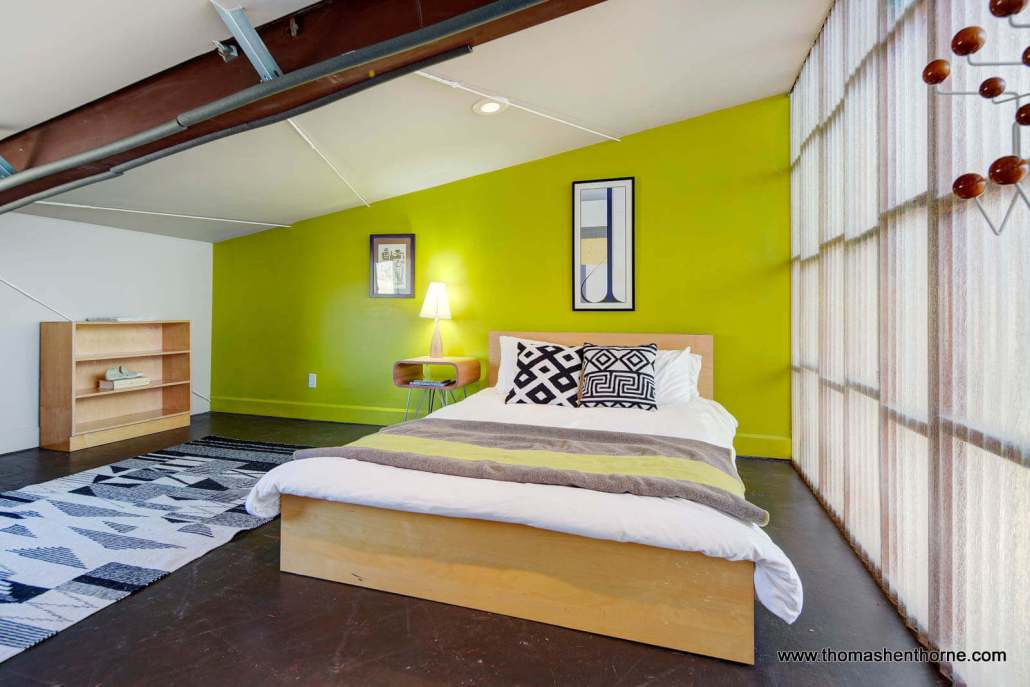 Modern bedroom with bright green wall