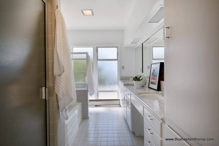 Bathroom with tile floor and frosted windows