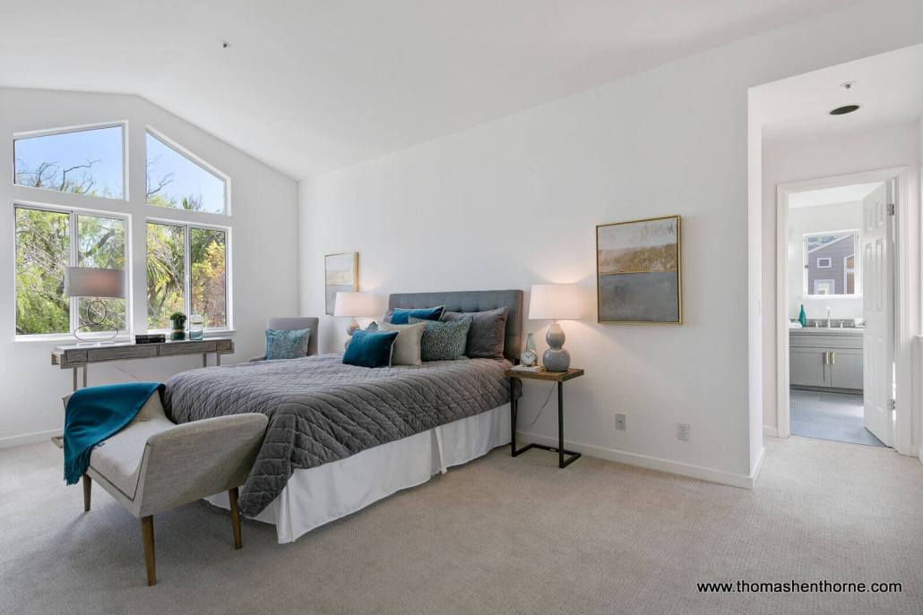 Master bedroom with high ceilings and lots of light