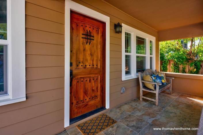 Front door on porch