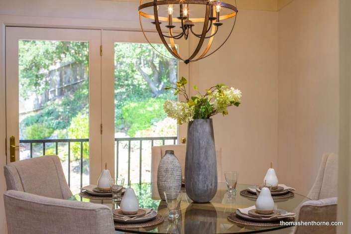 Round glass dining table and chandelier