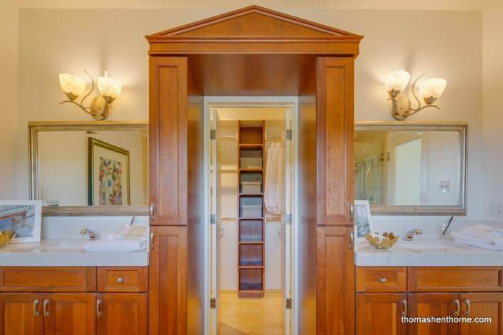Master bathroom with dual vanity and custom woodwork