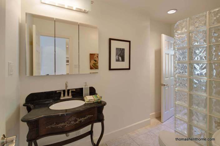 bathroom with ornate wood vanity