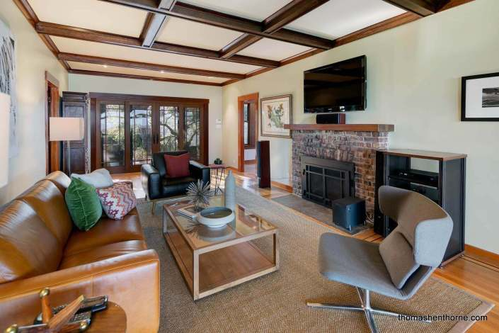 Room with brick fireplace and leaded windows