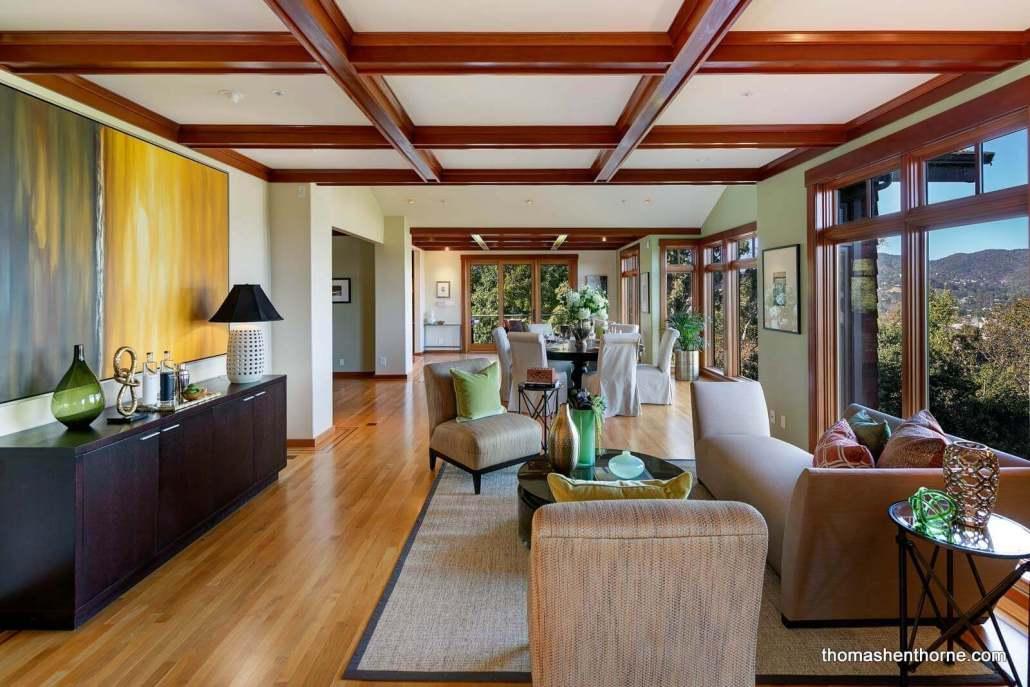 Coffered ceilings in room with hardwood floors