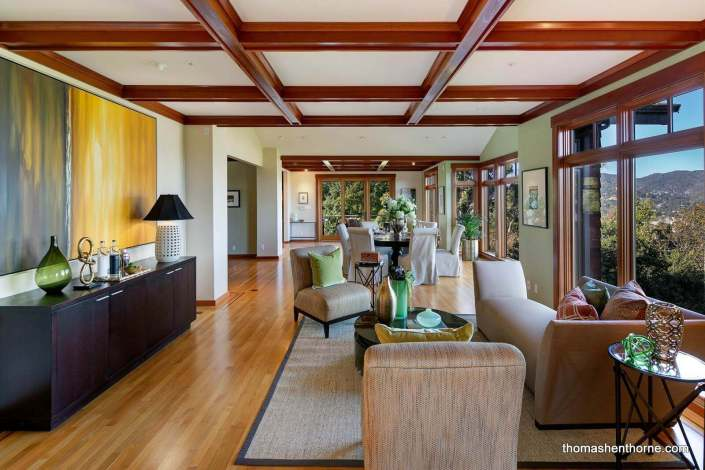 Coffered ceilings in room with hardwood floors