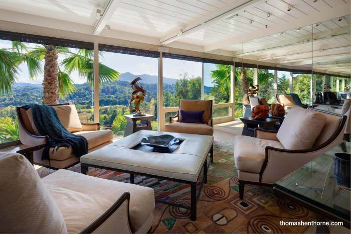 Living room with views of Mt. Tamalpais and open-beam ceilings