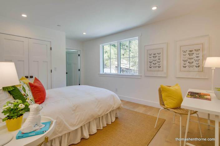 Bedroom with red pillow on bed