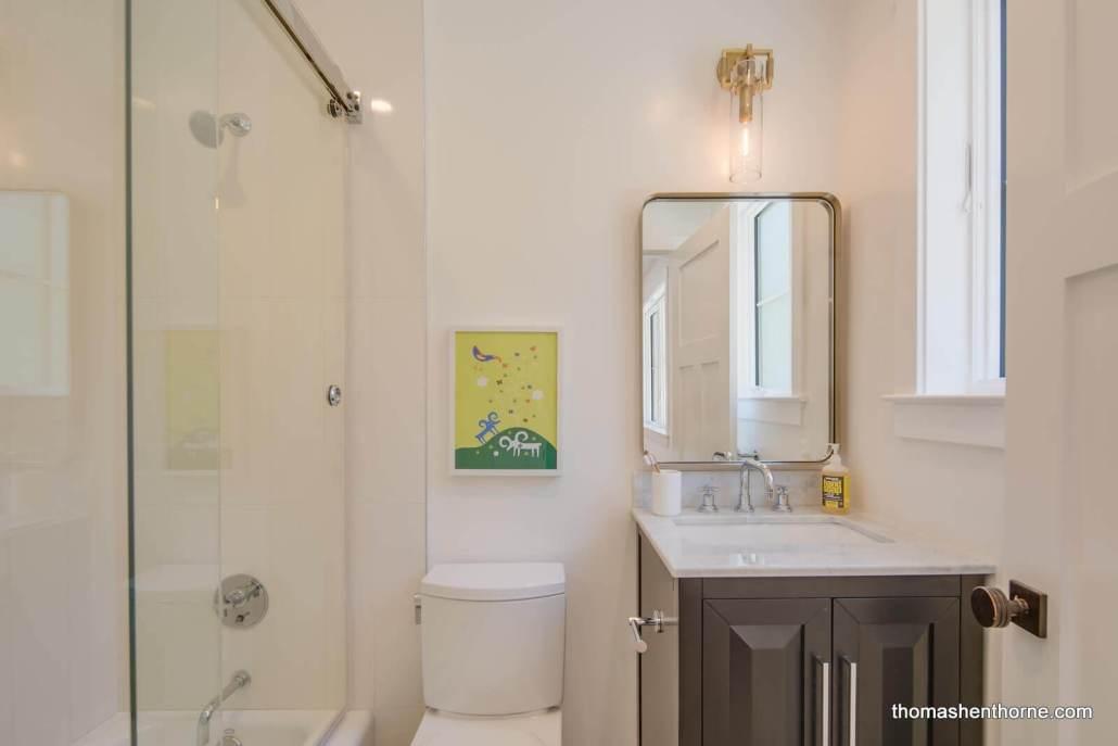 Bathroom with glass tub surround