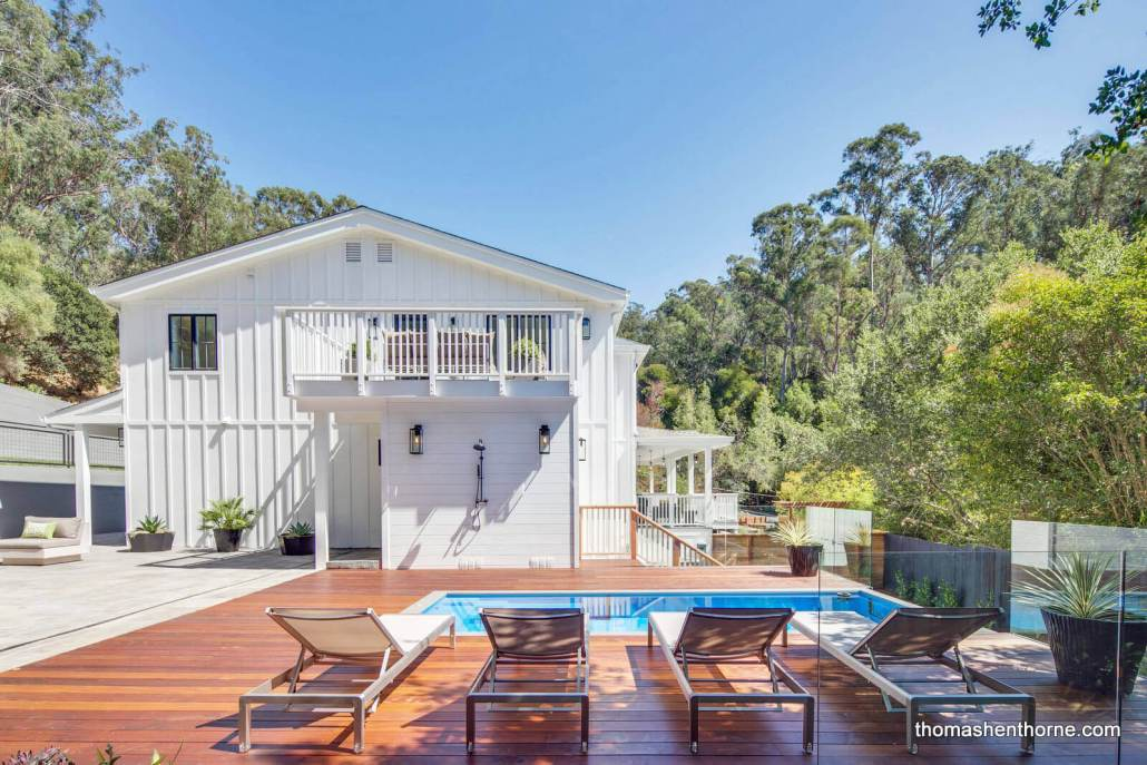 Ipe deck with modern deck chairs and pool