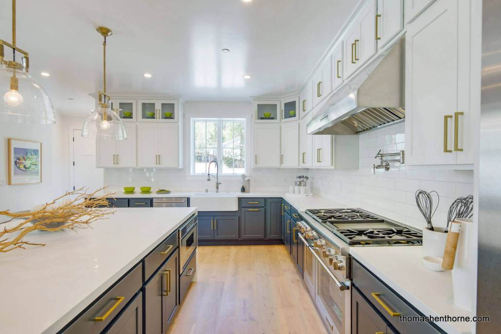 Kitchen with blue cabinets and gold handles