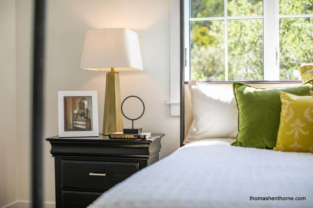 Bed and nightstand with photo and lamp