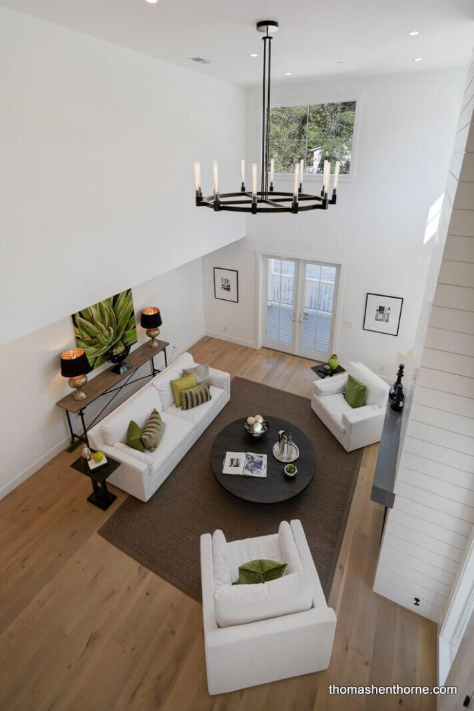 View of living room with sofa and two chairs from above