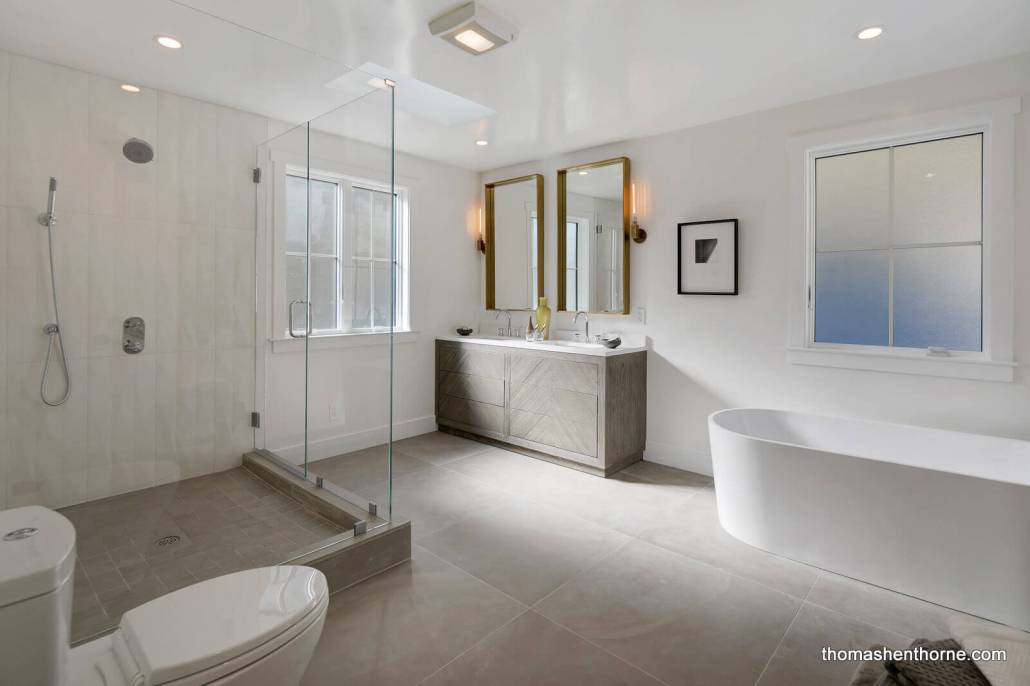 Modern master bathroom with soaking tub and glass shower