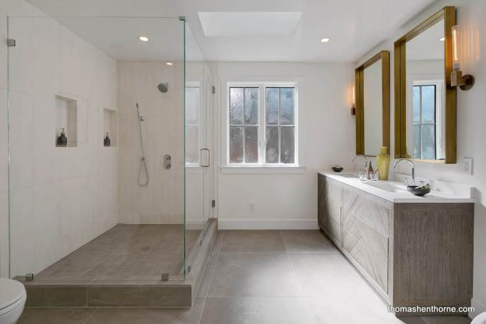 Modern master bathroom with glass shower surround