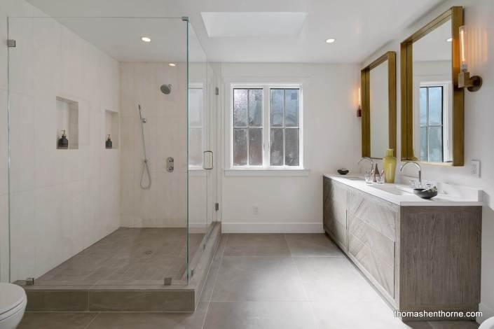 Modern master bathroom with glass shower surround