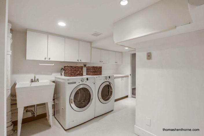 LG washer and dryer in laundry room with wash sink