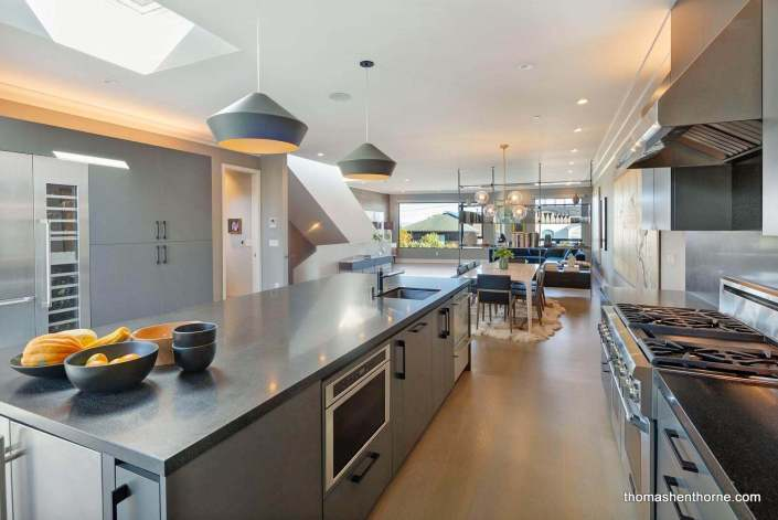 Kitchen with large range and enormous island