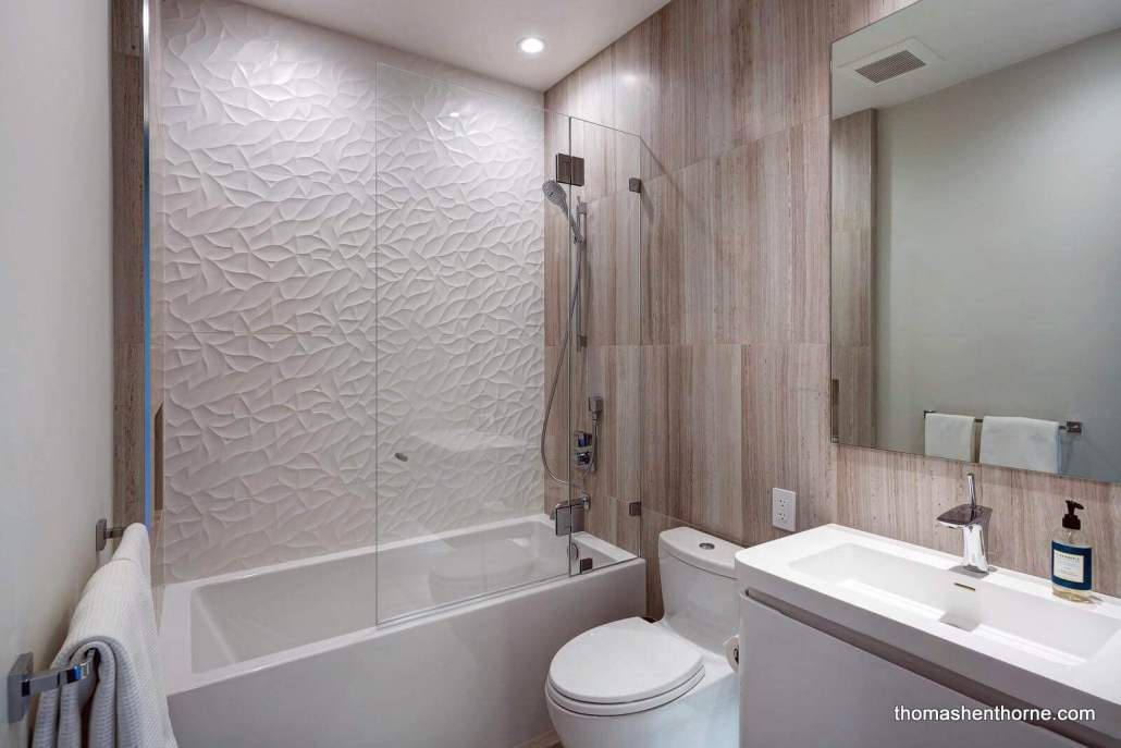 Bathroom with modern tile and tub / shower combo