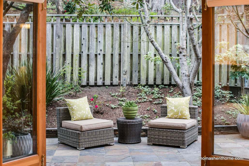 Outdoor seating area with two wicker chairs